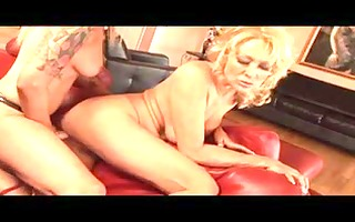 busty lesbian blonde bends over to take a
