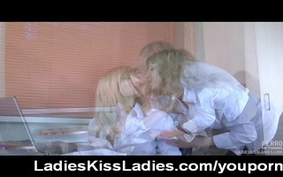 lesbo co-workers giving a kiss in the office