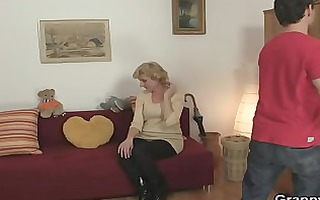 golden-haired granny jumps on his cock