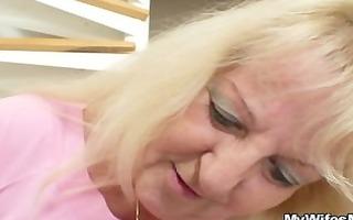 blond granny jumps on huge stud meat