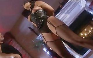 darksome haired pornstar in dark corset receives