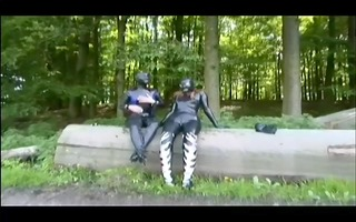 chicks in gimp suits play outside - absurdum