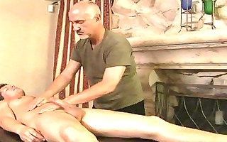 muscled tattooed gay acquires oiled and massaged