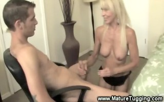 hawt cougar tugs on a younger cock