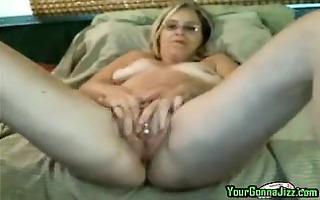 hot older milf rubs and fingers her vagina on cam