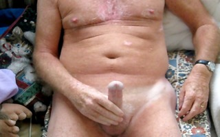 older man plays with teats then cums.