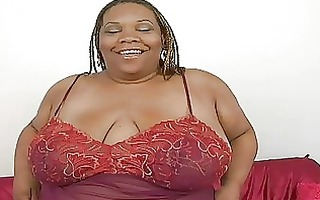 bulky ebon momma with huge bosom plays with her