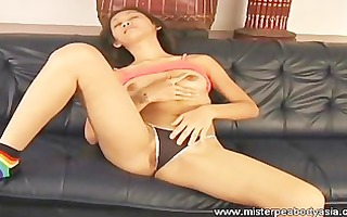 sexy oriental enjoys masturbating