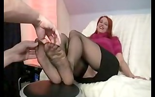 red haired girl tickled