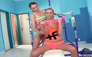 sexy lesbians exercise in the gym then begins to