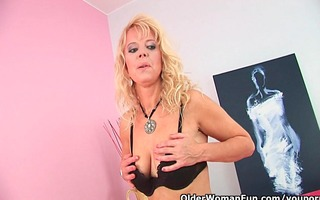 over 93 mommy probes herself with a large dildo