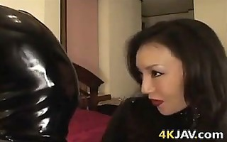 japanese cutie in latex dominating a dude