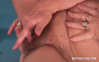 old lady masturbating her hairy vagina in close-up