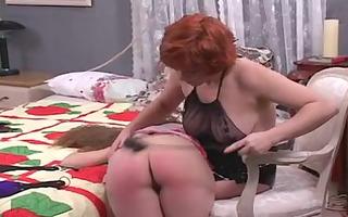 cute lesbian whore female-dominant spanks the