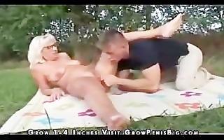 grandma fucks younger chap outdoors