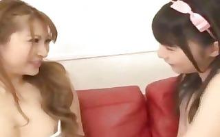 juvenile oriental gal giving a kiss spitting