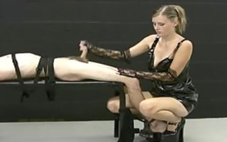 blond dominatrix jerks off her bound up serf and