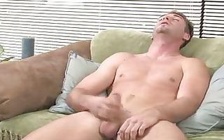 captivating brunette gay johnny rubbing his huge