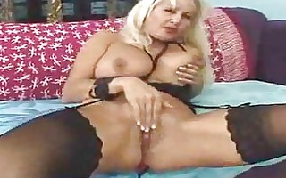 older playgirl in black nylons receives a