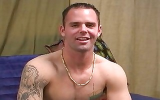 precious looking tattooed gay hunk undresses