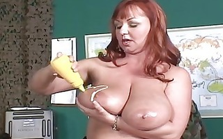giant boobed redhead mother i lotions up her