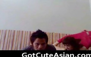 oriental non-professional pair fucking at home