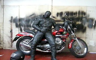 leather and rubber masked motorcycle jack off