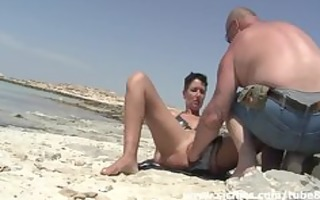dilettante wench fist drilled on a public beach
