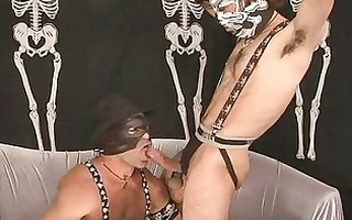 homosexual guys in masks having pleasure in sex