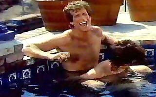 a pair bonks around in the pool in vintage porn