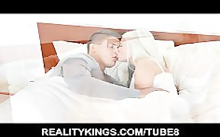 glamorous blonde wife wakes her spouse up to ride
