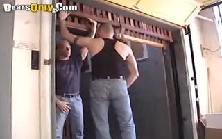 hirsute dudes giving a kiss passionately