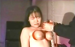 oriental tit bound suspended and waxed
